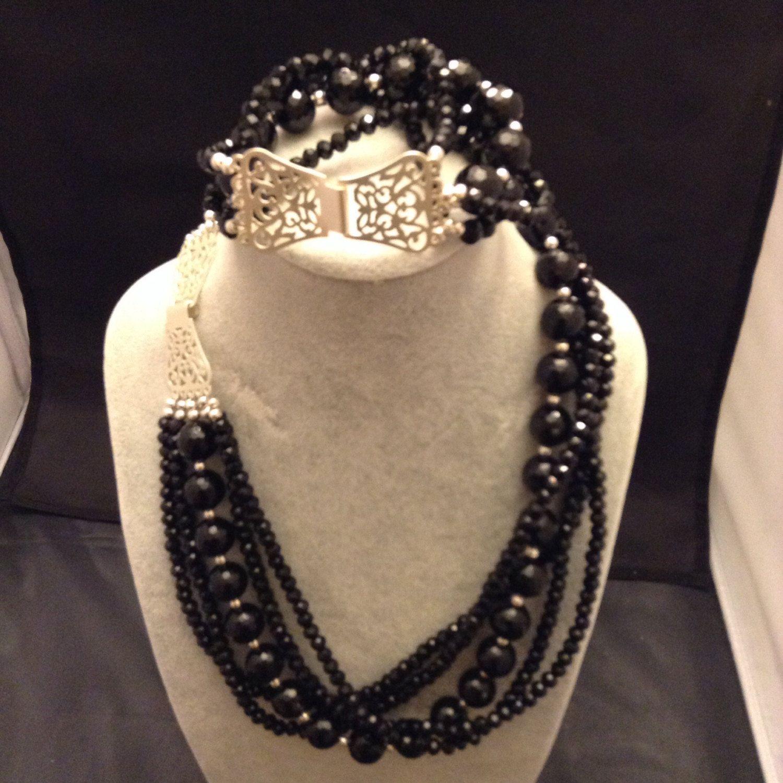 5 strand black onyx and Swarovski crystals and sterling silver
