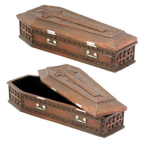 Hand painted for a natural wooden finish, this box is perfect for storing trinkets and small vampires. Made of cold cast resin. Hand painted. L: 8