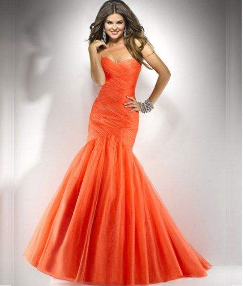 "This mermaid-like burnt orange prom dress by Flirt is ""muy caliente ..."