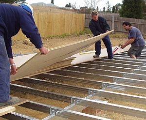 floor sheet being installed over a boxspan steel floor frame