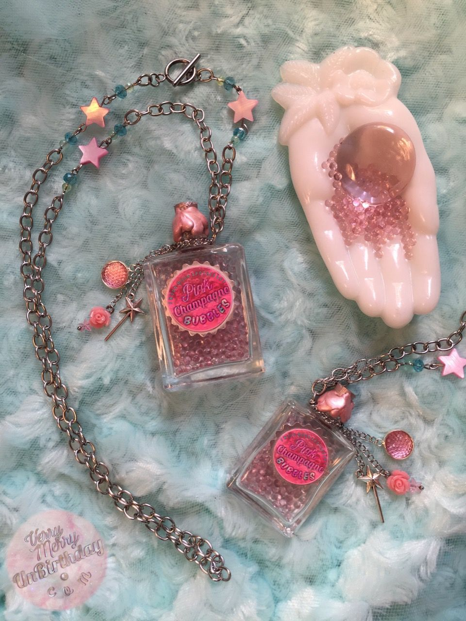 Toasting with pink champagne is one of my frilly fancies! I fashioned these little bottle necklaces to exude a vintage, timeless, feminine celebration of Bubbles & Pink!