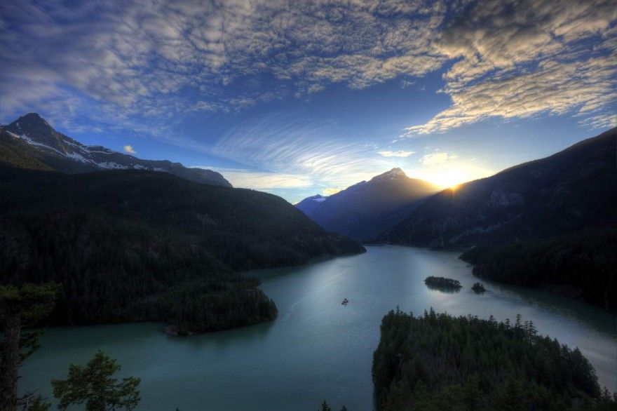 Diablo Lake is a reservoir in the North Cascade mountains of northern Washington state, USA. Created by Diablo Dam, the lake is located between Ross Lake and Gorge Lake on the Skagit River at an elevation of 1,201 feet above sea level.
