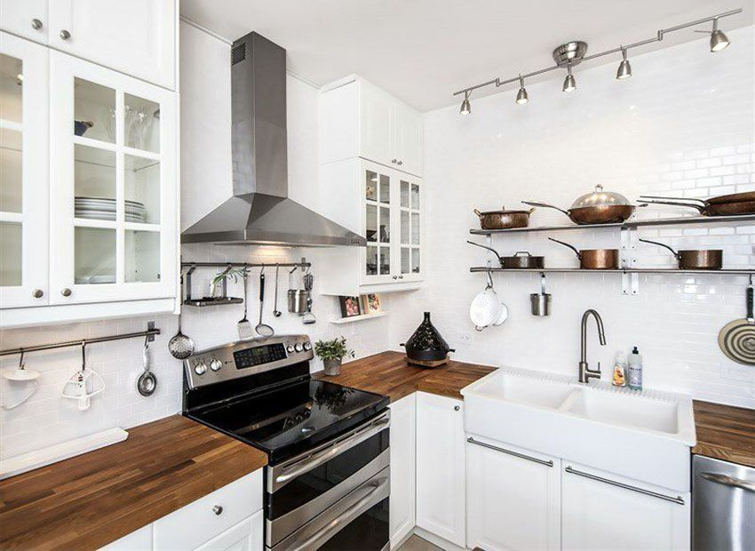 Small Country Kitchen With White Gl Door Cabinets Wood Countertop And Subway Tile Wall