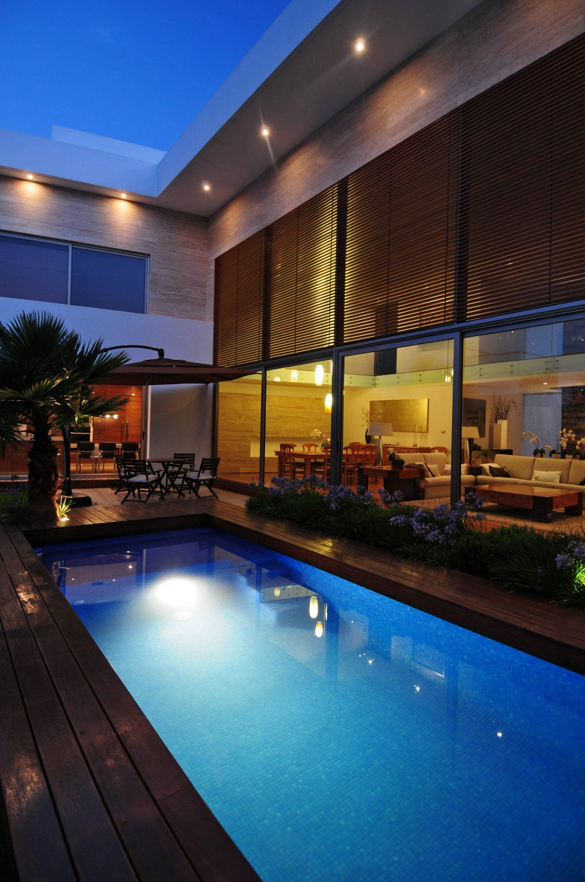Wonderful modern house design with glass wall and small lamp light also wooden brown floor complete · swimming pool