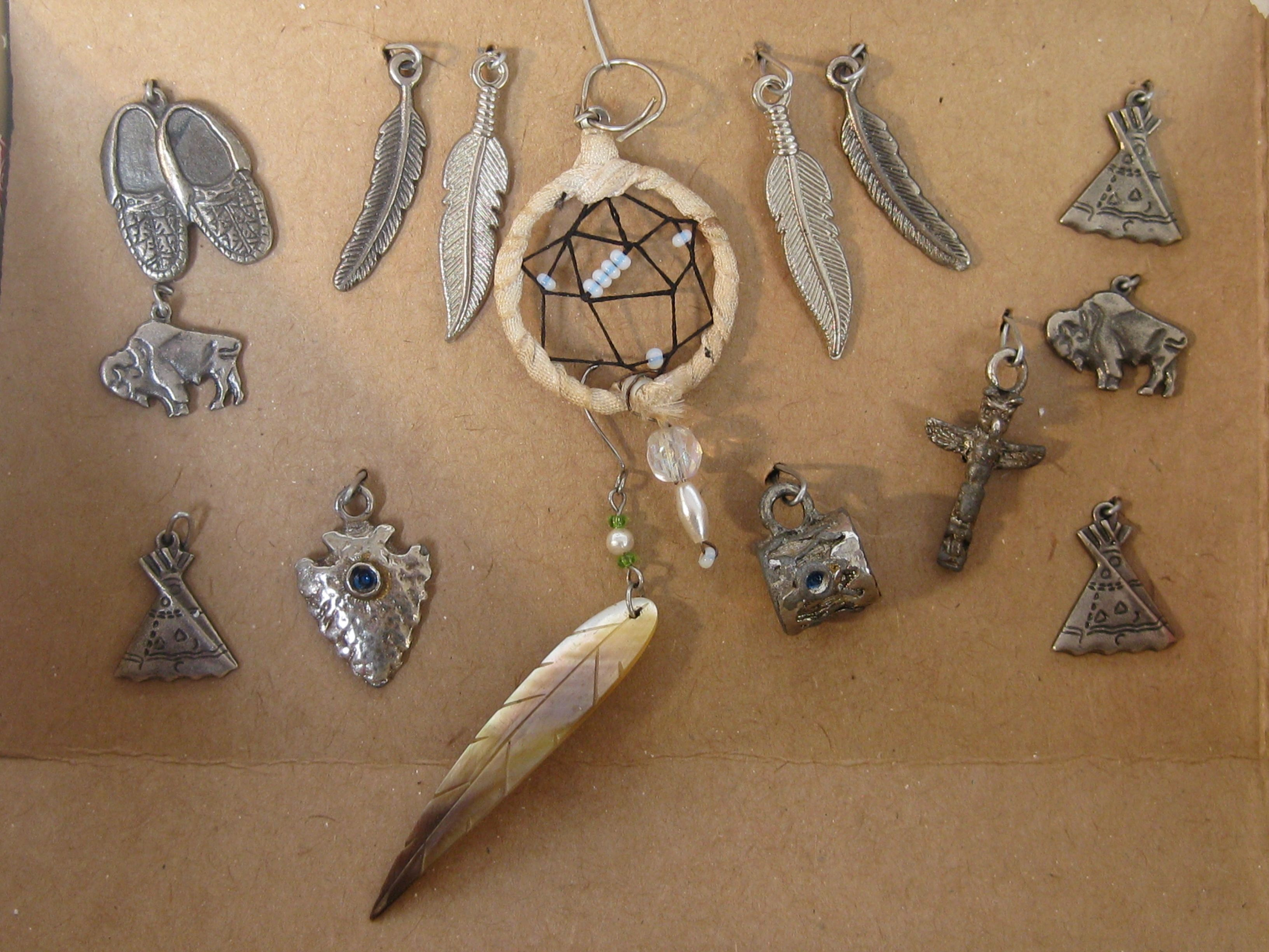 Native findings and charms collection the totem spearhead and drum