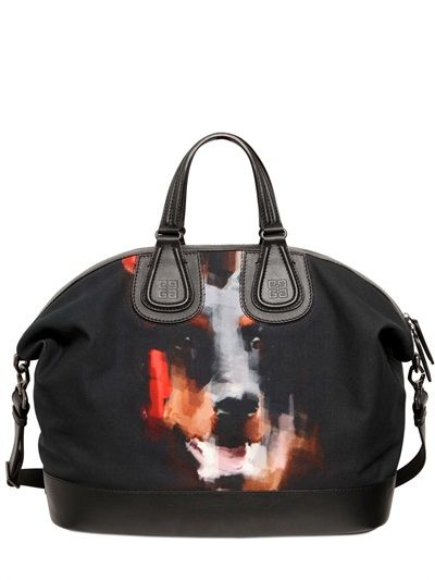 Givenchy does it again.  Love the Doberman + Nightingale bag.