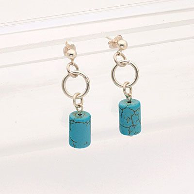 Earrings made of cylindrical turquoise beads. Handmade unique one-of-a-kind earrings. Length:3,5 cm