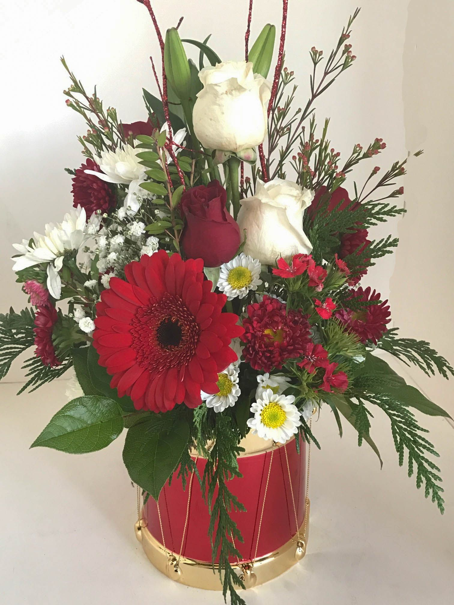 Drum Filled With White And Red Roses Gerberas Other Flowers And