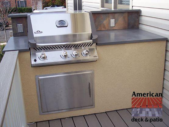 "concrete counter. 6' island outdoor kitchen. 12"" ht. tile back"