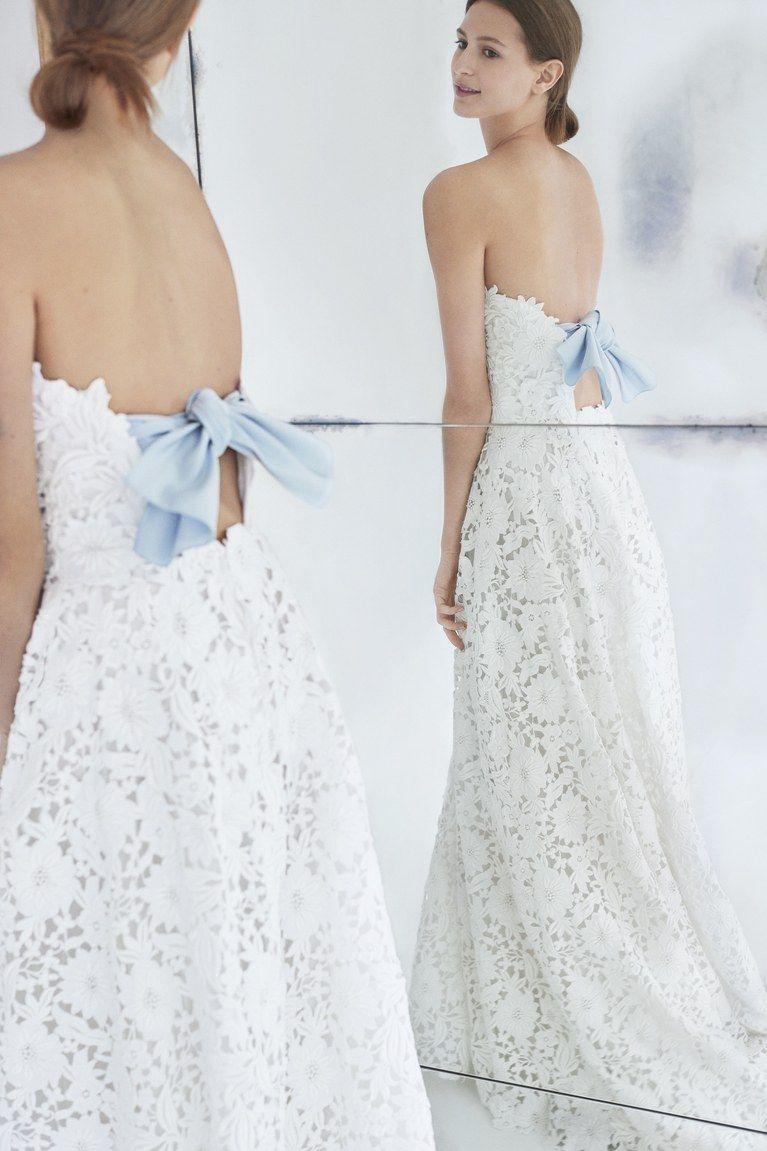 Carolina herrera strapless embroidered wedding dress with blue bow