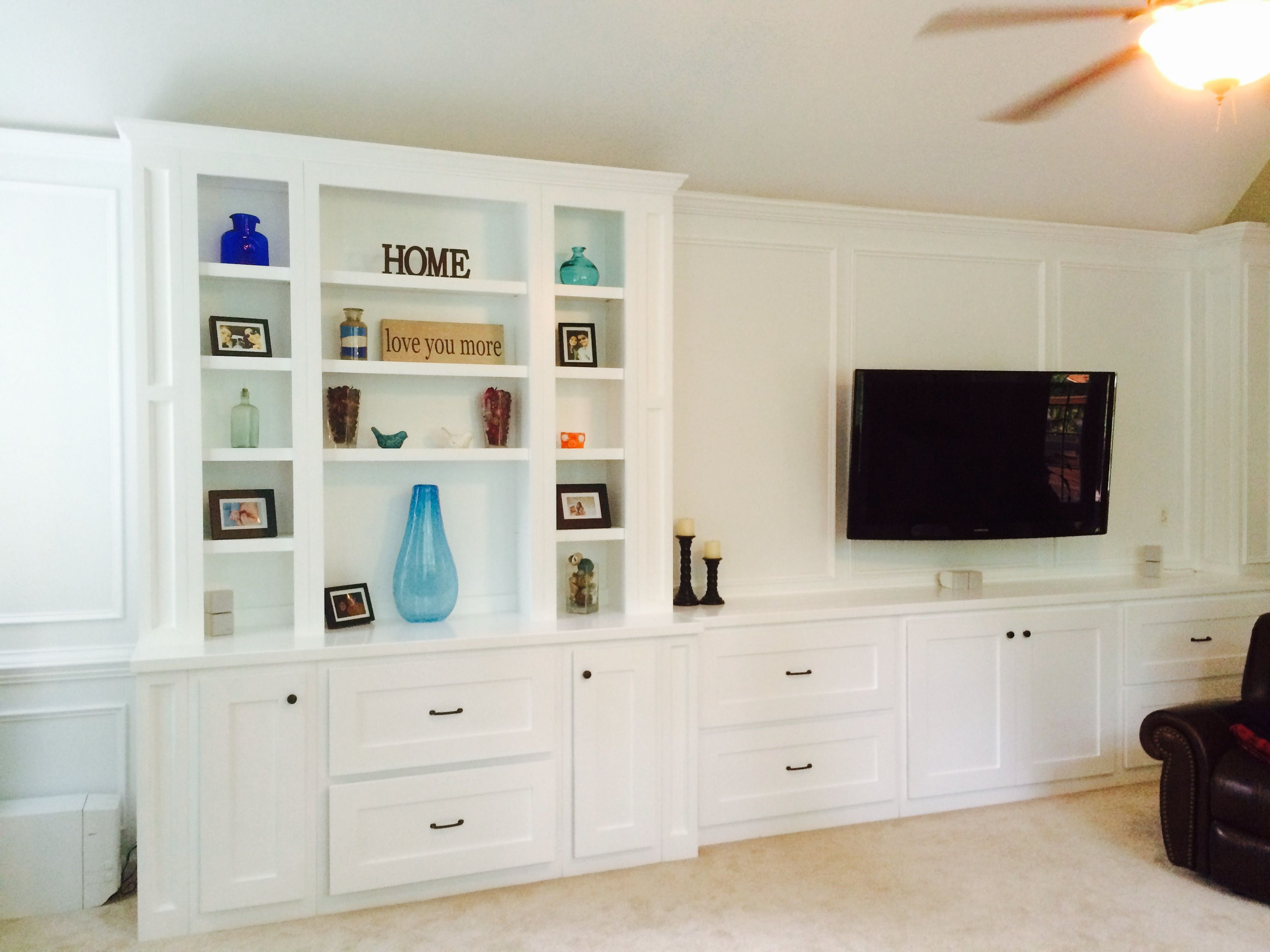 Gorgeous White Built In With Paneled Entertainment Center Gives This Piece