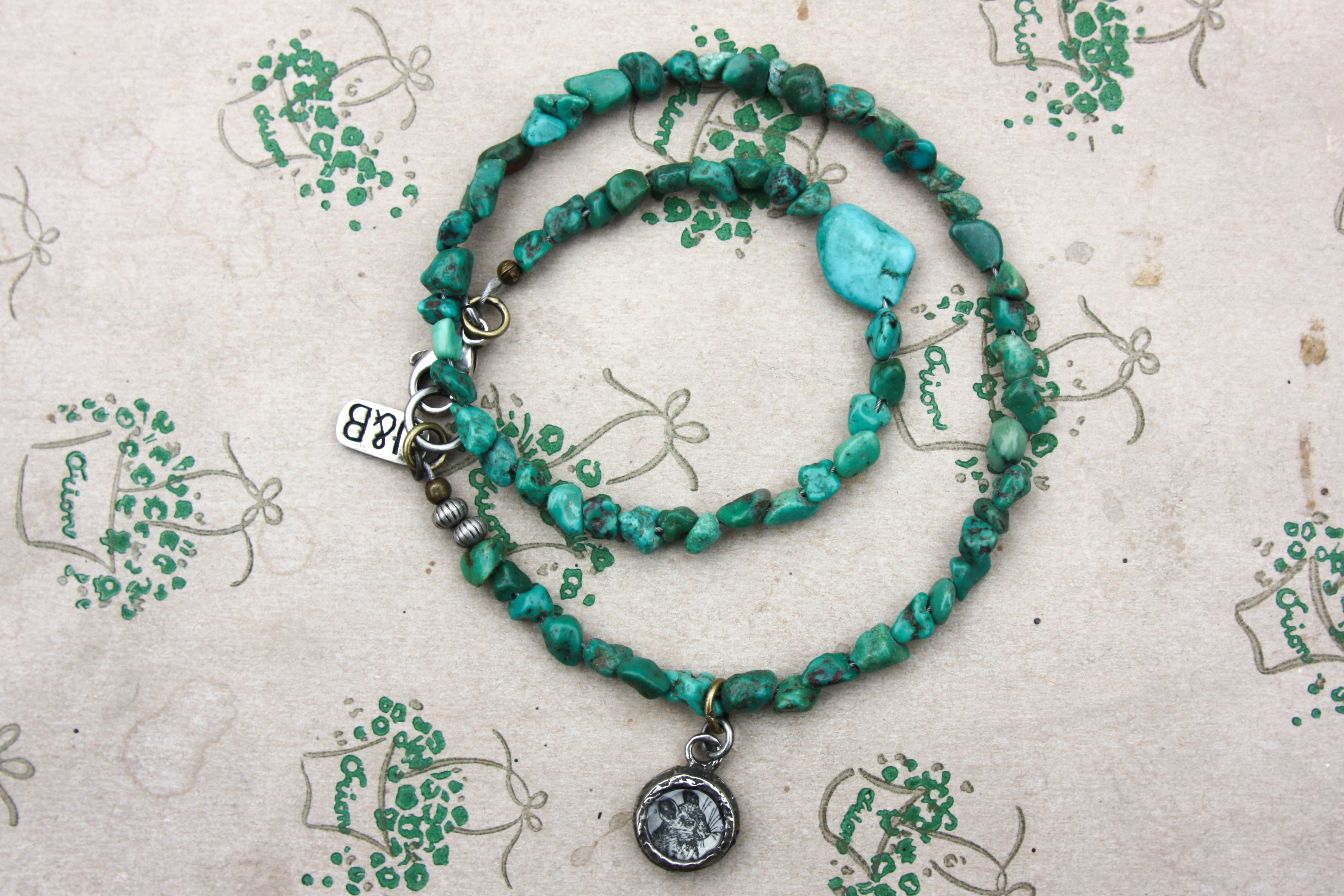 Goodluck! Bracelet made of beautifull turkoois stones and handmade medaillon with old image from Larousse.