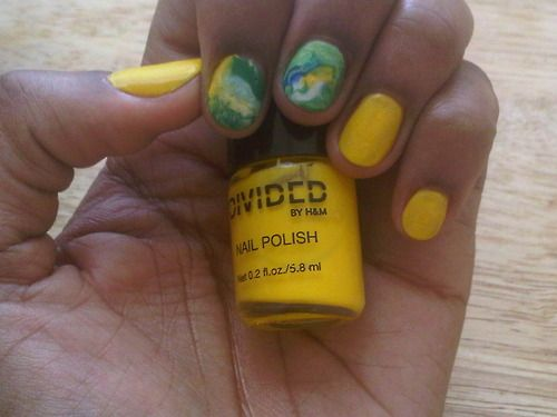 Yeah I can do nail art too. Check out my marble design paired with color of the season sunny yellow.