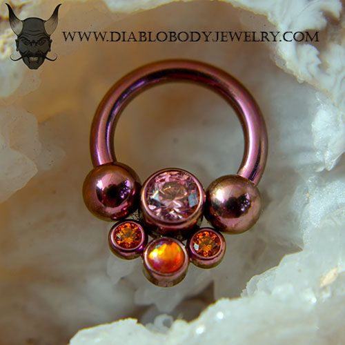 Anatometal Circular Barbell Cluster Ring. Ti: Fushia, Gem Colors: Salmon Pink, Tangerine, and Bold Red Opal #45. Great for Daith, Nipple, and Septum Piercings