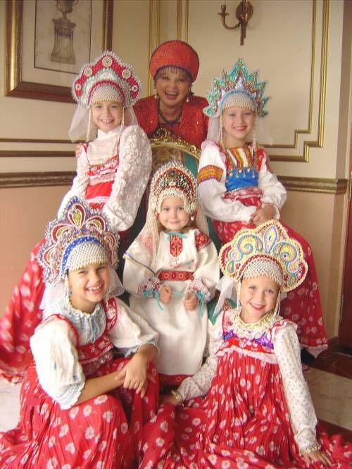 b582755fc Traditional Russian costumes. I love the little girl in the middle. What a  dumpling!