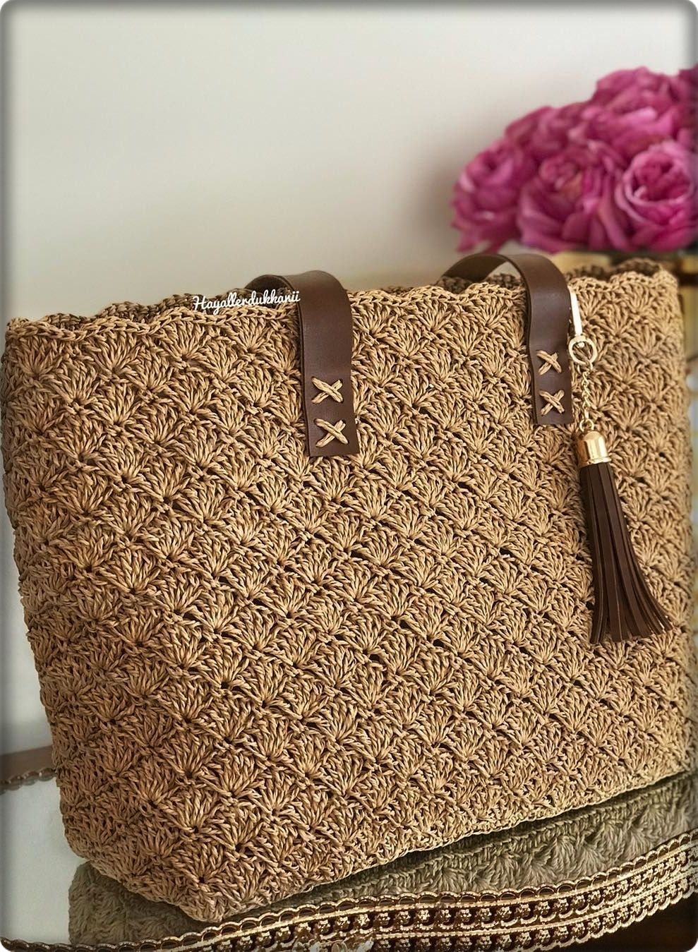 2019 March Crochet Bag Pattern Ideas. New fashion brown color knitting shoulder bag for ladies. #crochethandbags