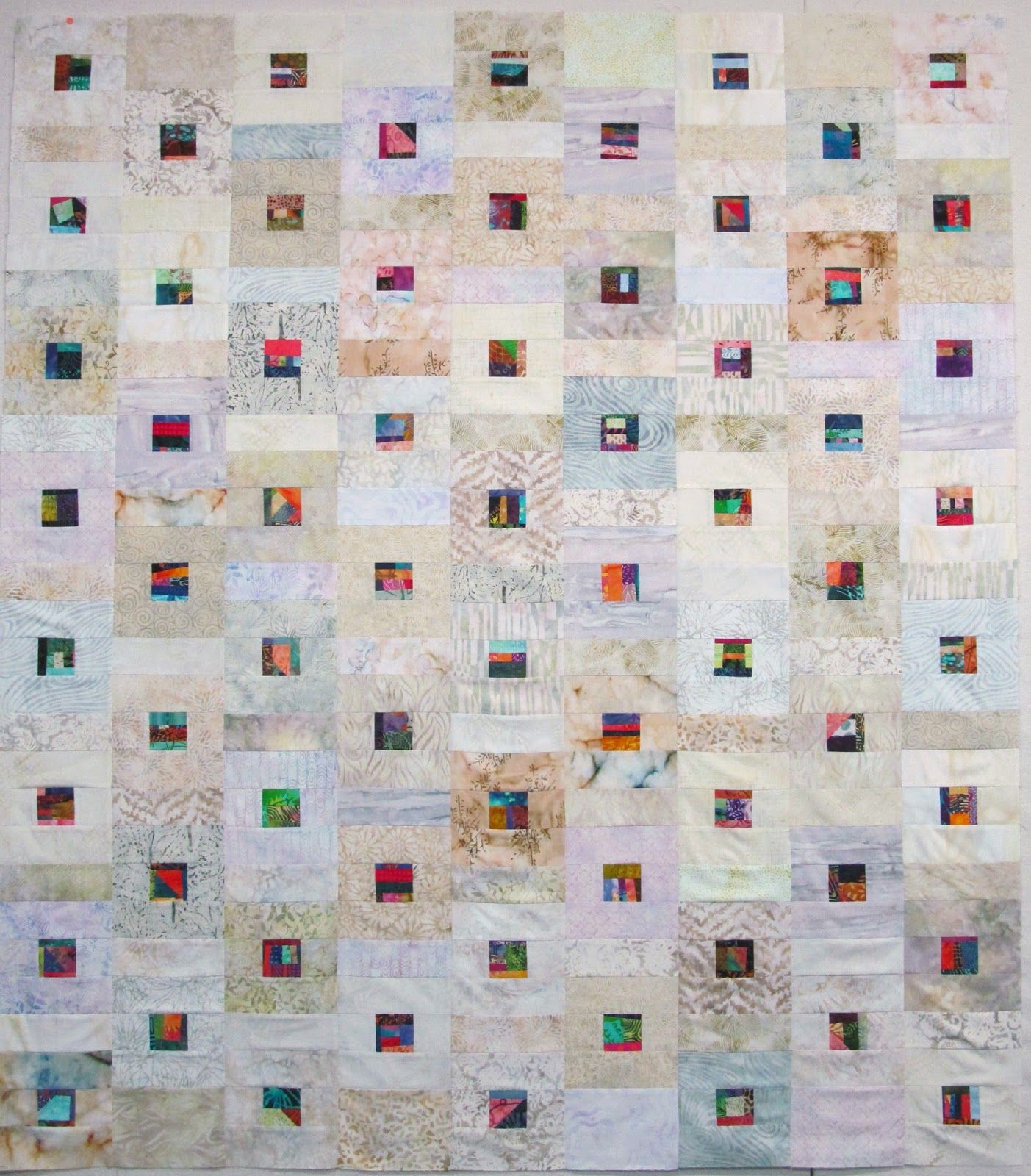 Exuberant Mix Of Colors And Patterns: Neutral Scrap Quilt By Wanda Hanson