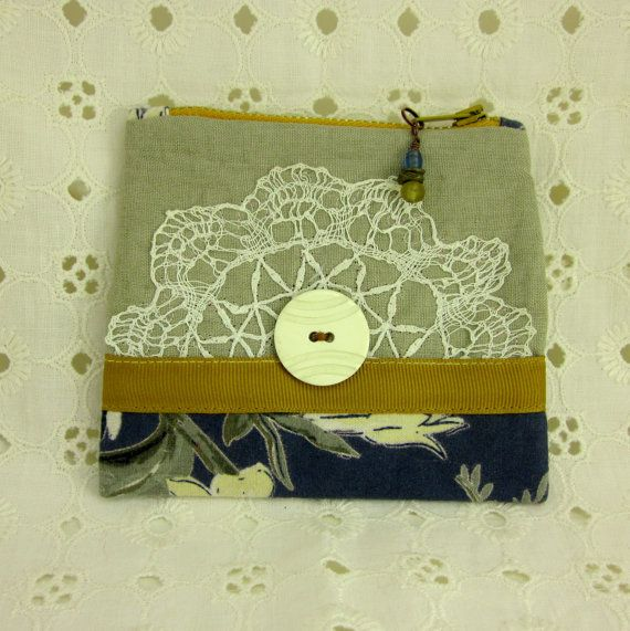 Handmade linen with vintage doily and button.
