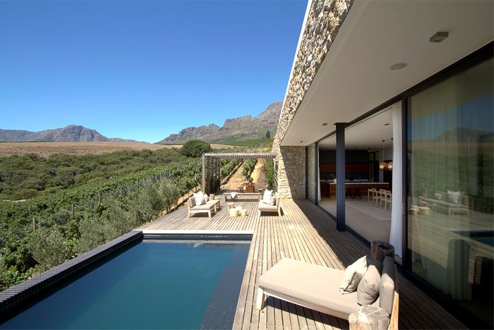 Romantic hillside vineyard villa modernist architectural waterspout roof house