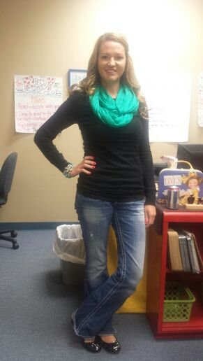 Black pullover sweater or long sleeved t-shirt, jeans, flats, and a pop of color.