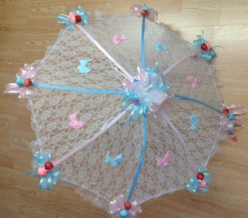 Antique white and pink baby shower decorated baby shower for Baby shower umbrella decoration ideas