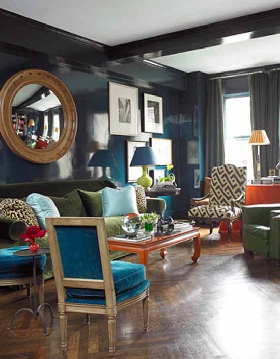 In this living room designer miles redd used multiple colors and pattern that help your eye weave through the space the blue lacquered walls in farrow