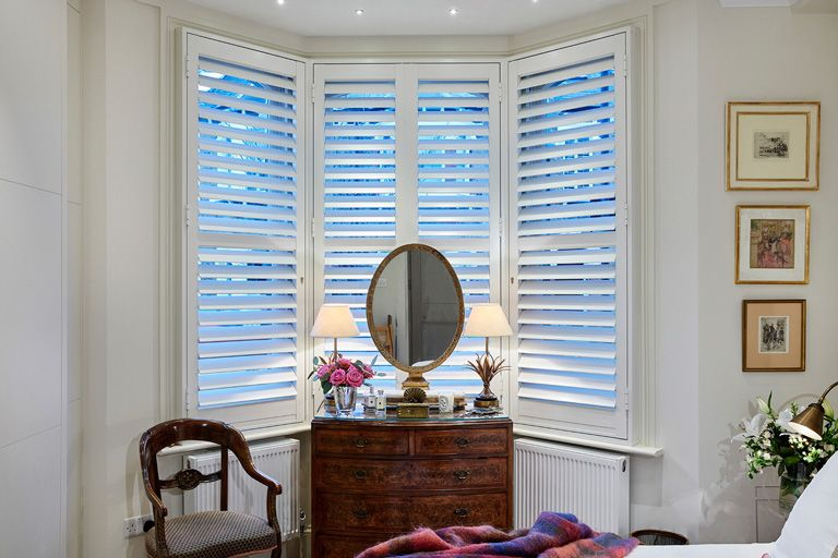Security Shutters for living room bay windows by The