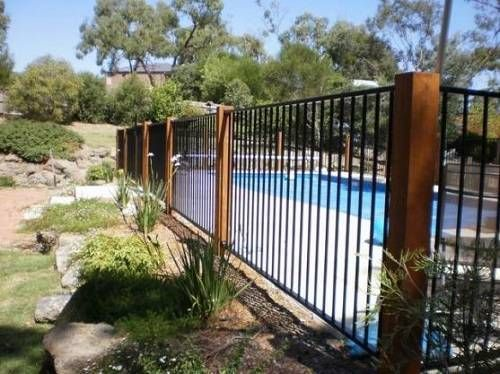 13 Latest And Elegant Wrought Iron Pool Fence Ideas Backyard Pool Landscaping Fence Around Pool Glass Pool Fencing