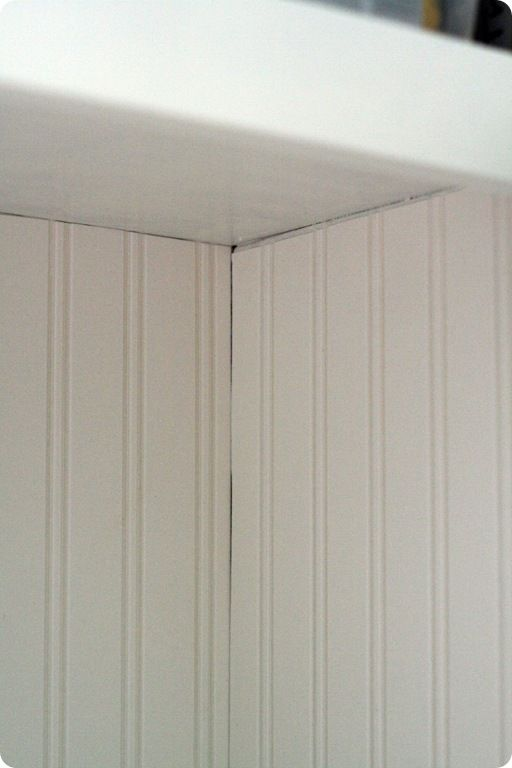 beadboard wallpaper and then caulk to hide the uneven lines; paint over it. cute inside cabinets ...
