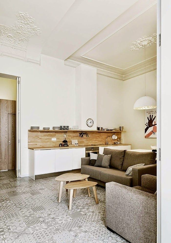 I love the neutral  tile floor from an APARTMENT IN BARCELONA BY INTERCON.