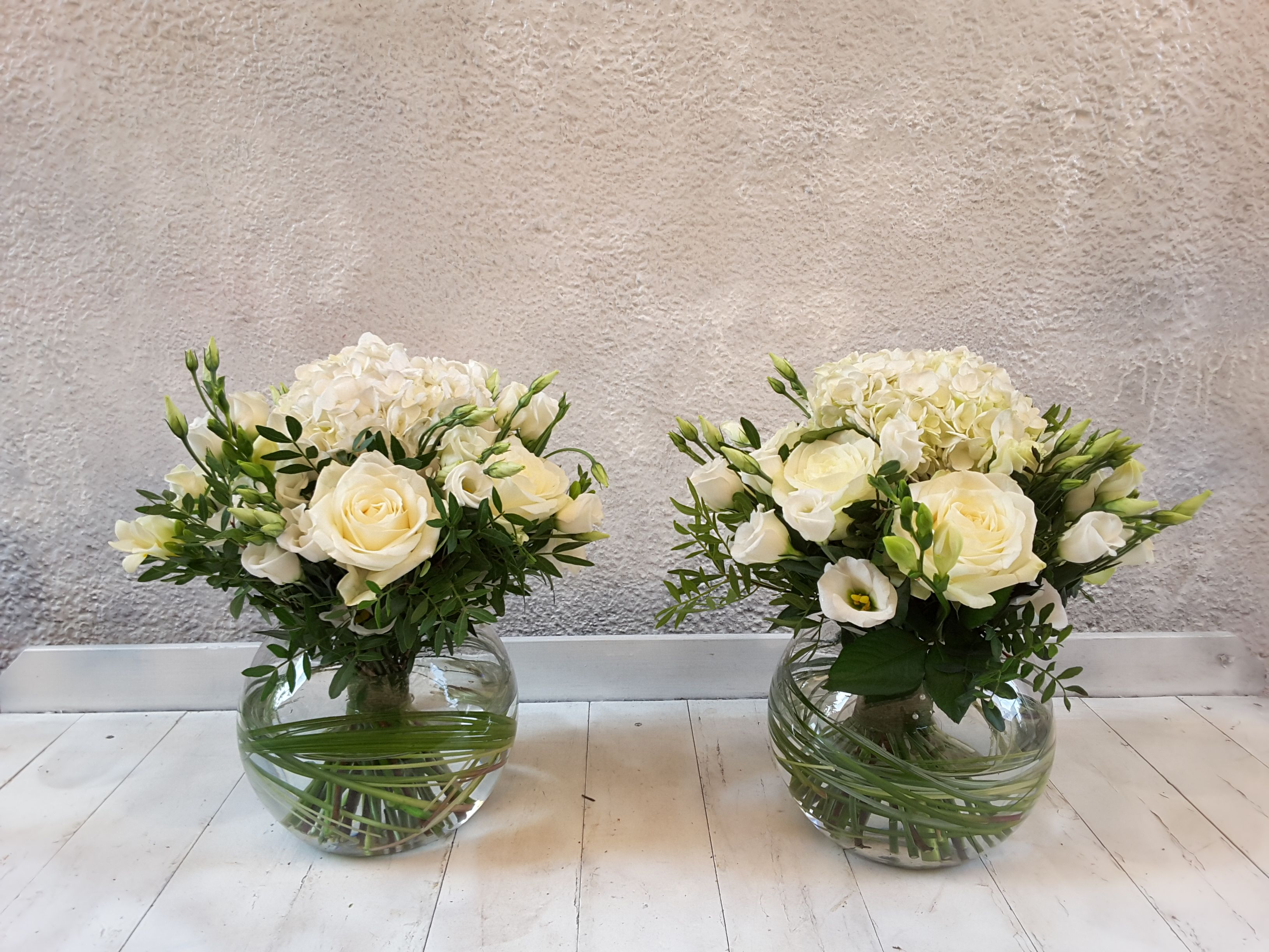 White Hydrangea, Rose, Freesia and Lisianthus in a clear