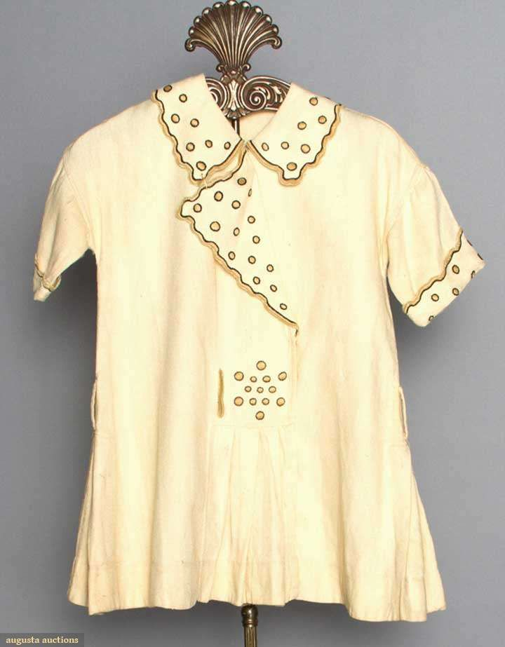 FOUR LITTLE GIRLS' DRESSES, 1908-1918 2 silk party dresses: 1 apricot; 1 pink; 2 day dresses: 1 white cotton w/ polkadot embroidery; 1 Hungarian beige linen w/ red embroidery;