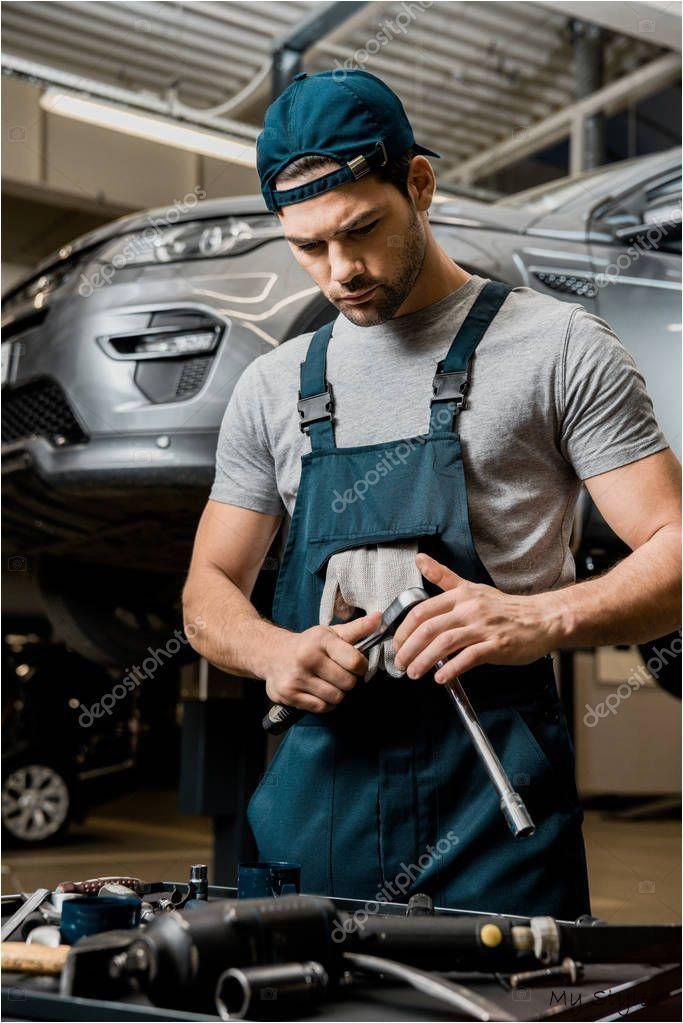 Portrait Auto Mechanic Uniform Lug Wrench Auto Repair Shop ...