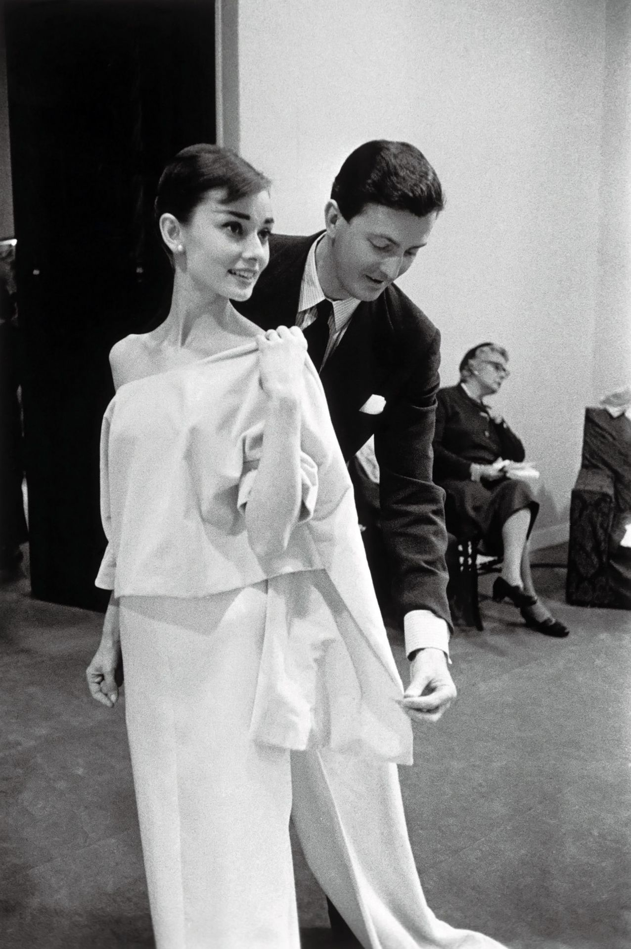 Hubert de Givenchy styling a model on Audrey Hepburn, his muse.
