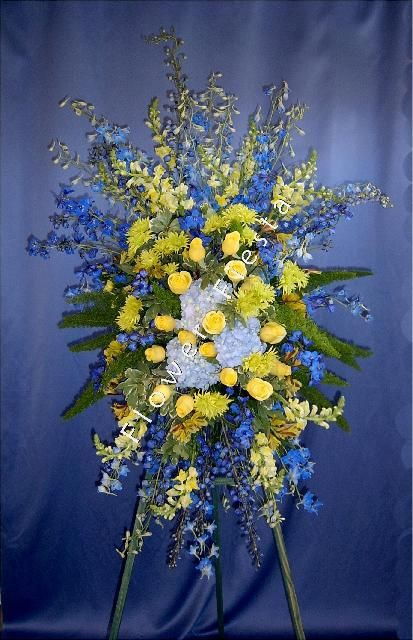 Blue And Yellow Church Arrangements Luminous Blue Green And Yellow Standing Spray Large Yellow Flower Arrangements Large Flower Arrangements Funeral Flowers