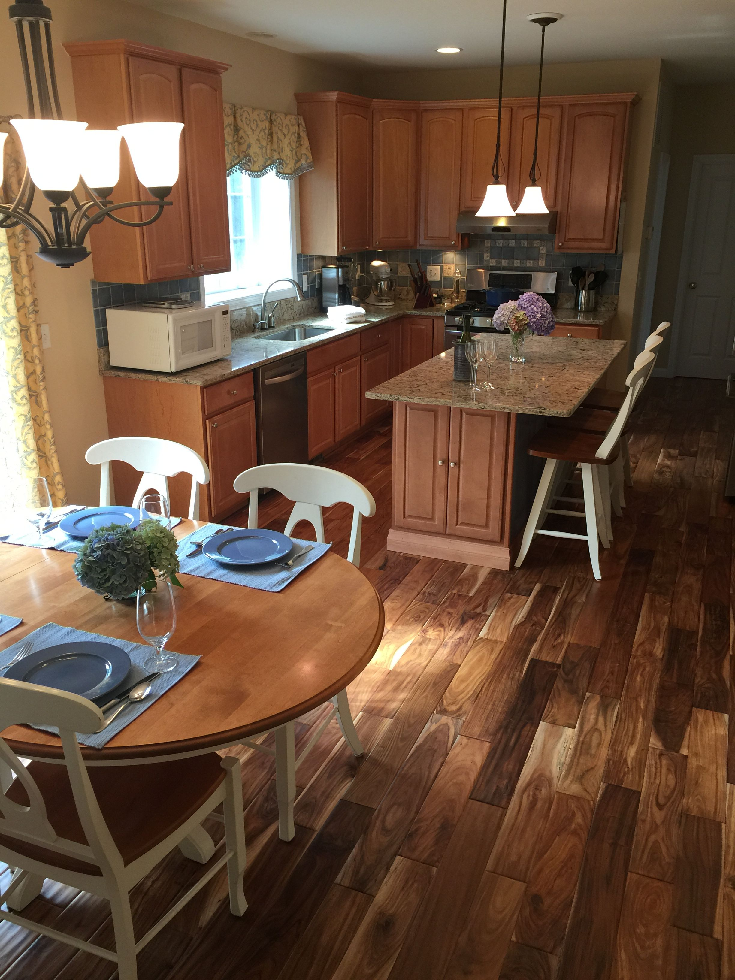 """#AFamilyFeast picked Tobacco Road Acacia for their kitchen makeover! Here's what they had to say: """"The team at our local Lumber Liquidators store was a wealth of knowledge and patiently answered all of our (many!) questions throughout the entire project.  Don't be shy about asking them for help!"""" More:  http://www.afamilyfeast.com/our-kitchen-makeover-after/"""