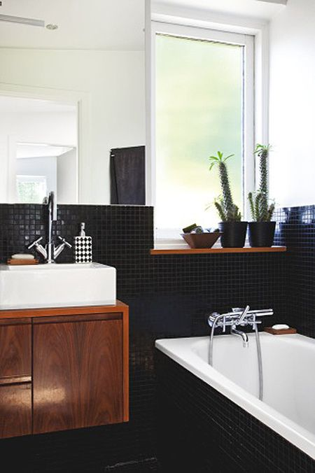 I adore the small black tile in this bathroom. Not a fan of the  wood choice though.