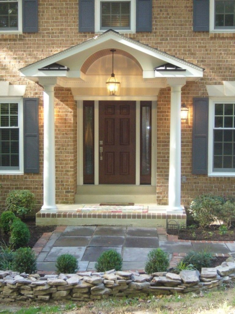 Exterior illuminated front porch impressive decorating ideas using grey wooden siding panels and rectangular white pillars also with rectangular brown