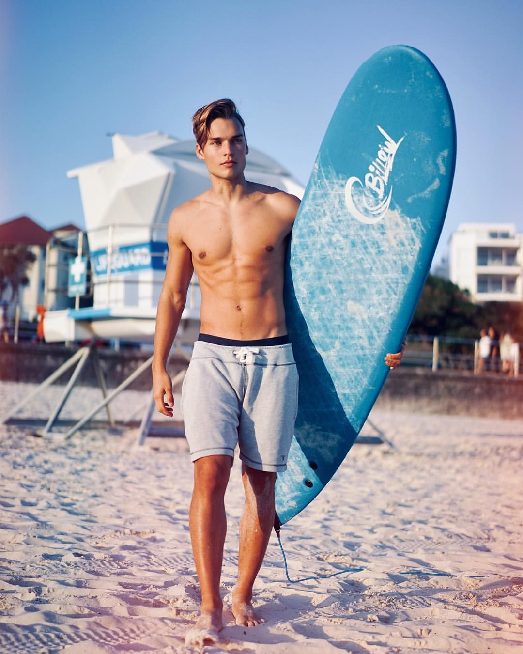 This gay pro surfer came out to his mates when a grocery clerk hit on him