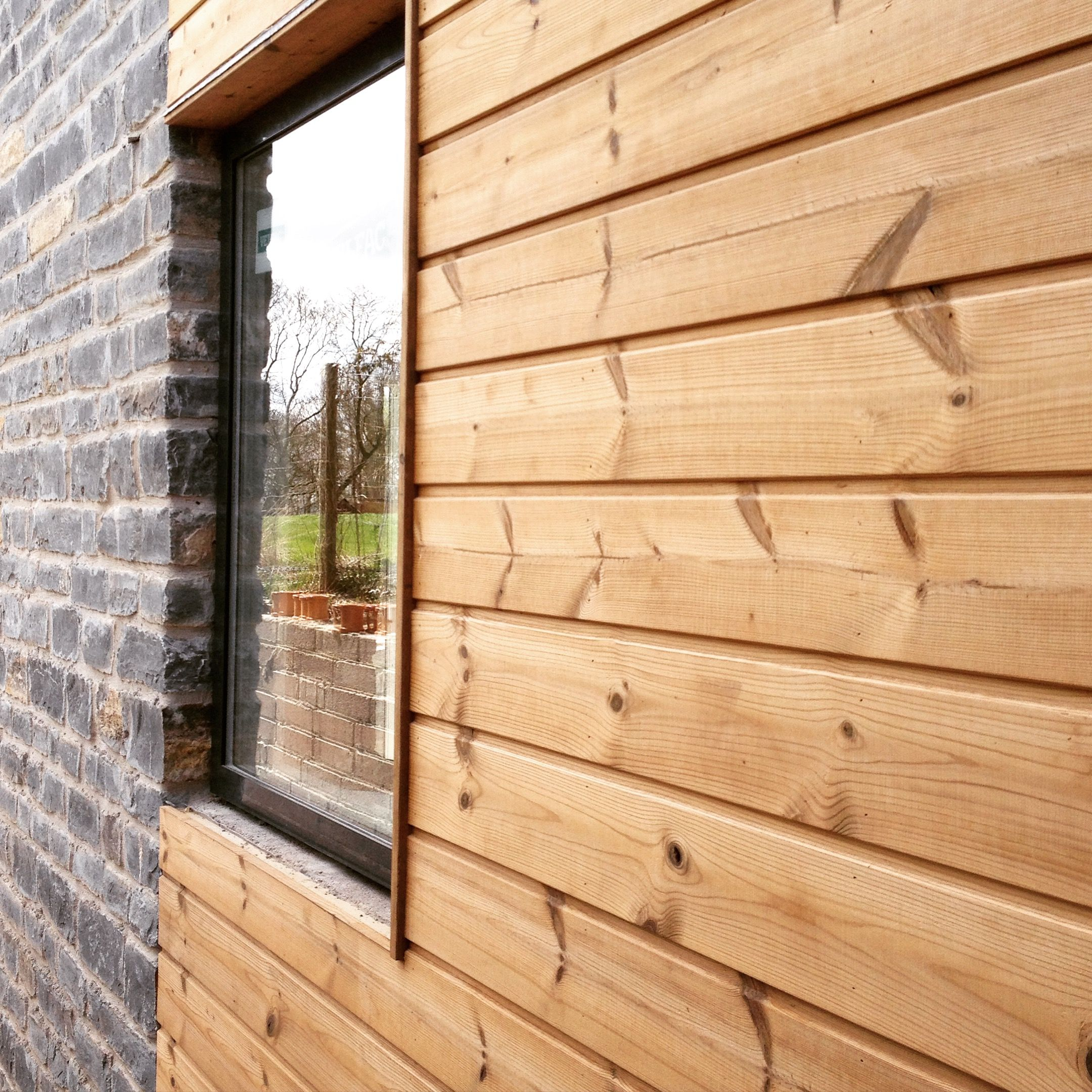 Wooden Cladding Detail ~ Eco homes in somerset completion due summer