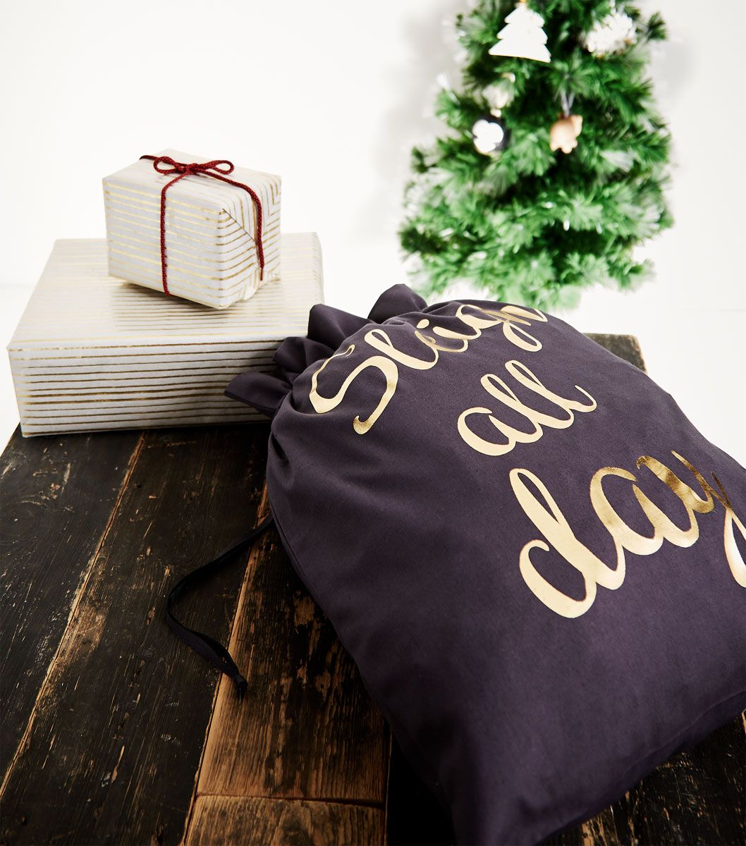 Have Christmas bagged up with this printed present sack