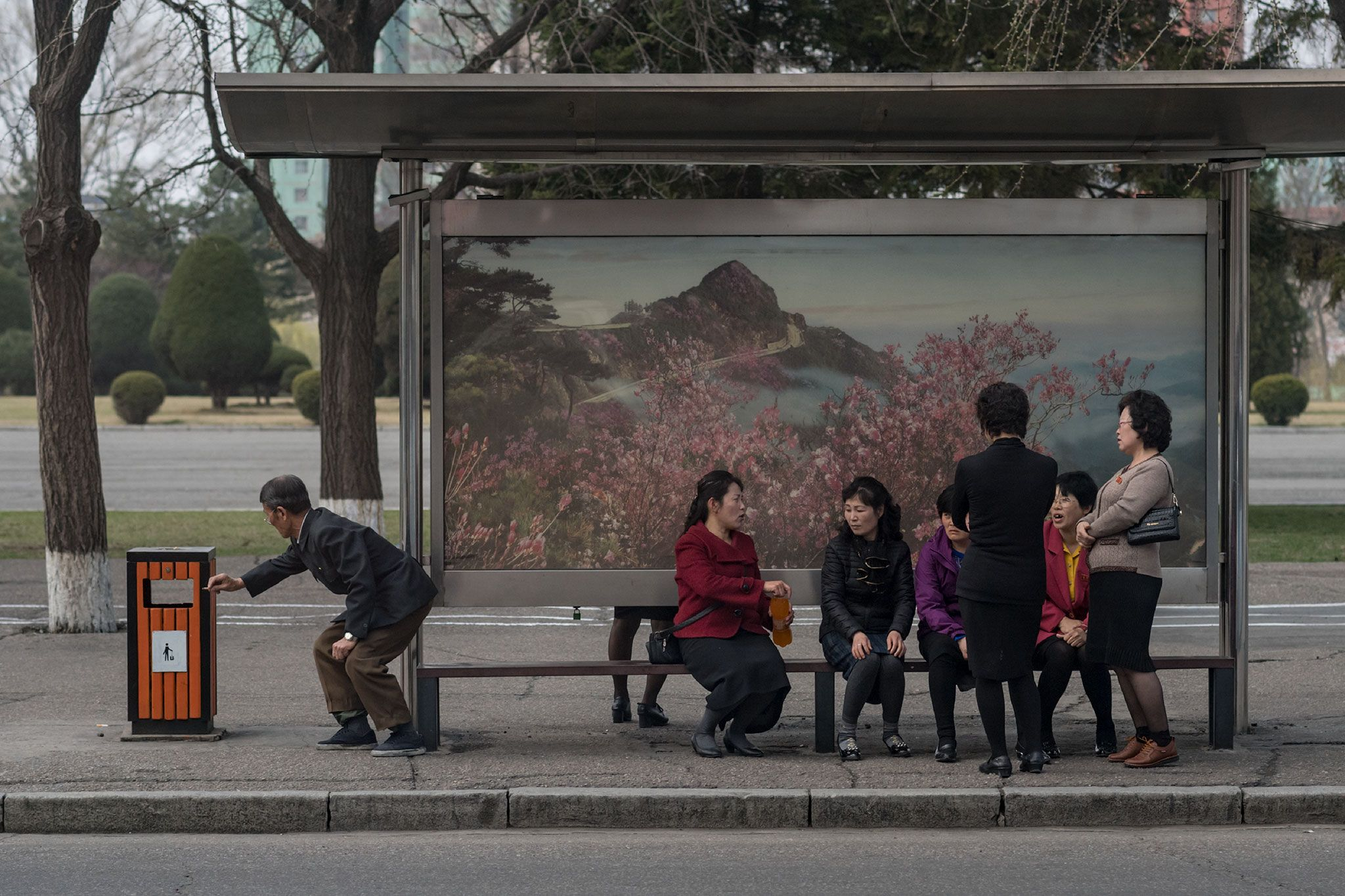Picture Of People Waiting At A Bus Stop In North Korea With