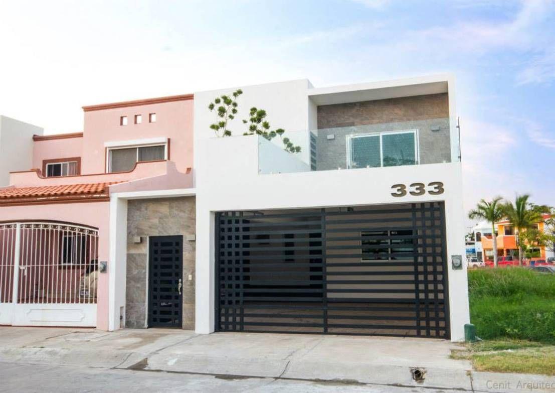 Casa at casas modernas de cenit arquitectos fachadas for Fachada de casas modernas con porton