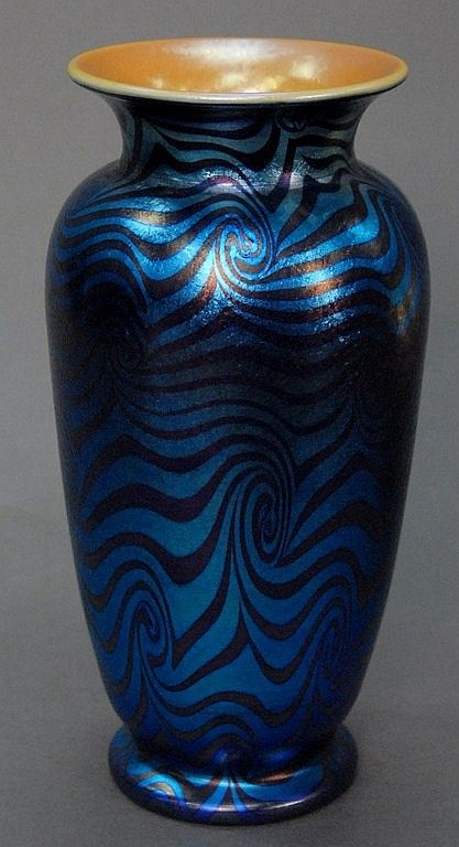 Durand art glass vase blue irridecent with pulled silver, unsigned. Provenance: From the collection of Thomas and Alice Kugelman. ht... Provenance: 10in. Starting Bid: USD 250   Bids Placed: 2 Watchers: 4 Nadeau's Auction Gallery Click image for more info...