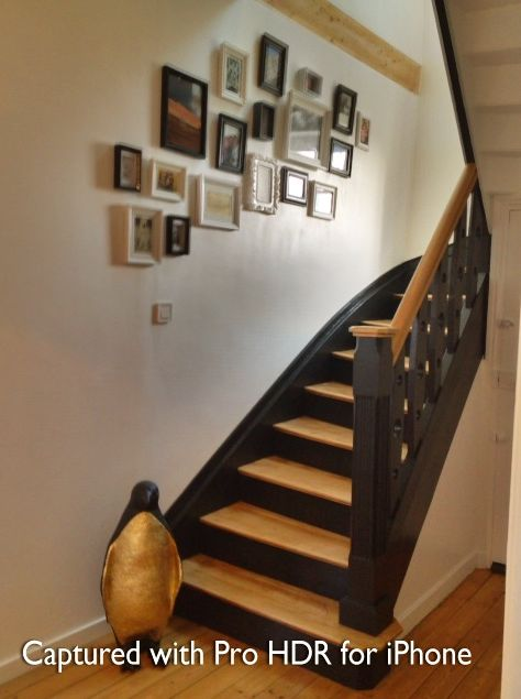 Love the black risers with natural treads! Might need to redo ours!