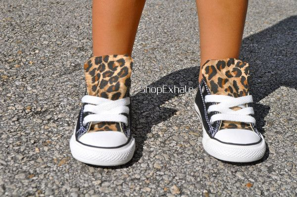 This item ships within 6-10 days of purchasing. The 'Hear Me Roar' Converse from our Mini Me line. Finished to perfection. Iconic. Custom authentic black low-top Converse, embellished with cheetah print on the tongue and back strip. Hand made by our style-savvy team. Made in USA. LoveShopExhale