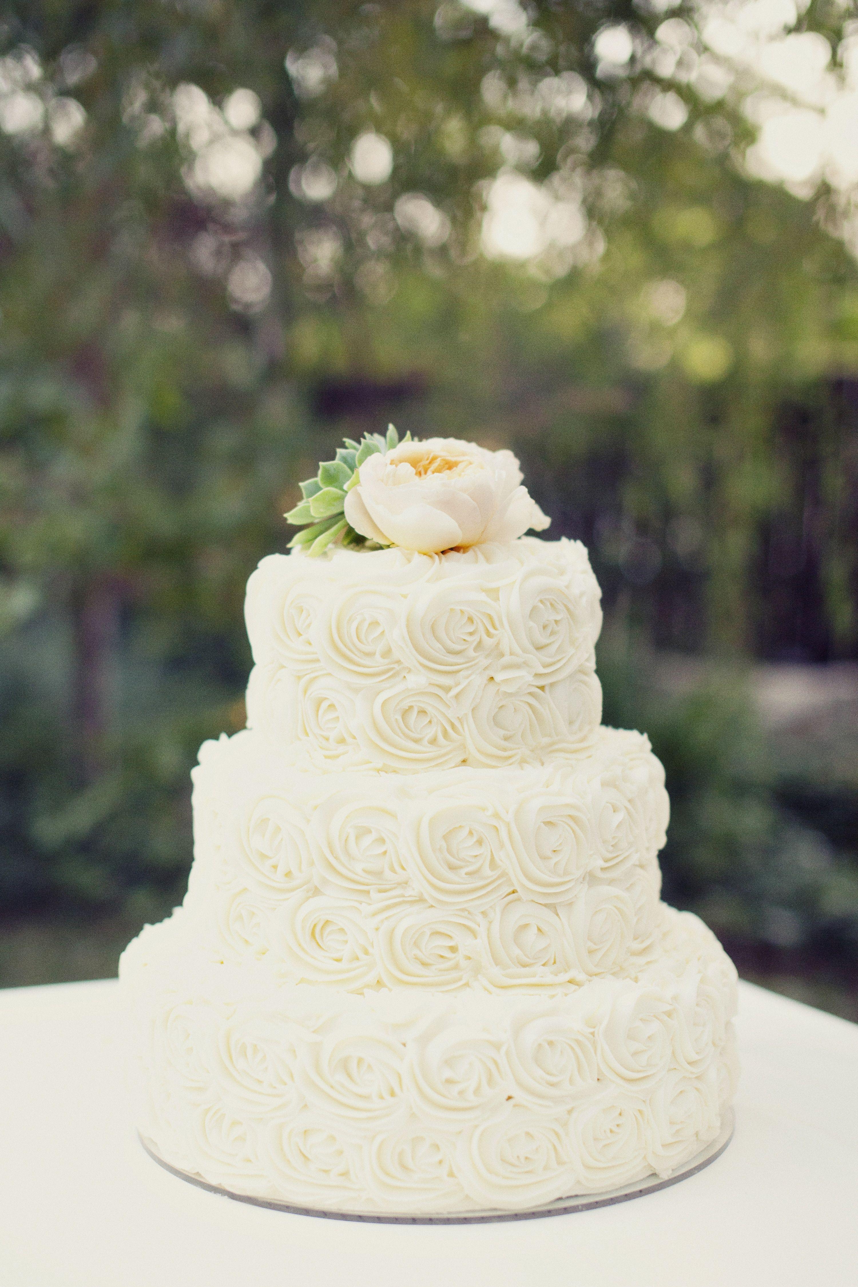 Ivory rosette wedding cake wedding cakes by dawna for Simple wedding cake flowers