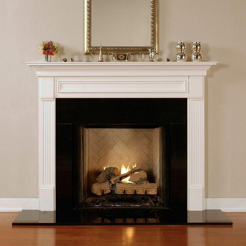 Nice Fireplaces: Simple Black Surround Against Nice Wood Floor.