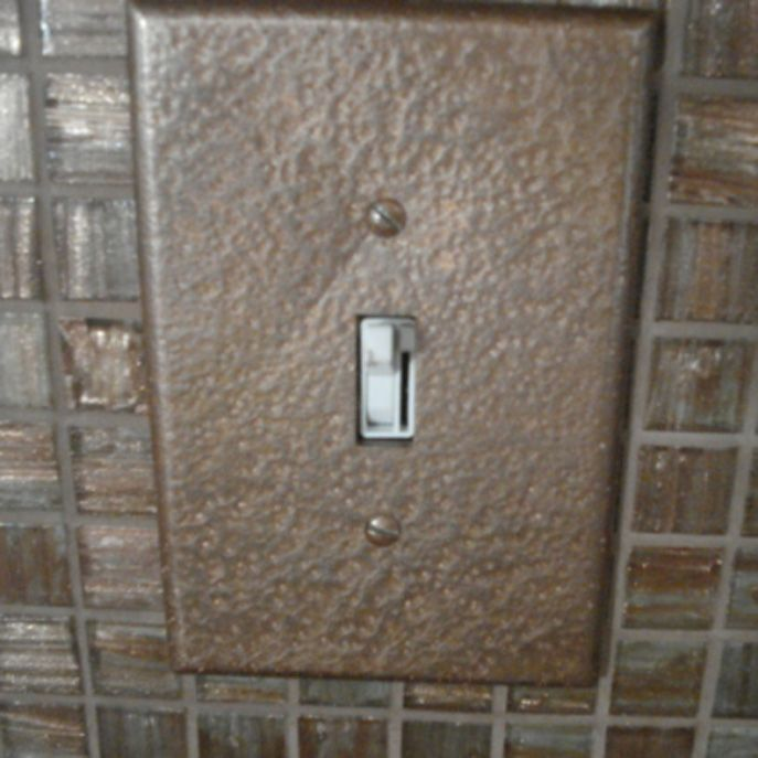 Sockets and light switch plackets with rustoleum hammered paint - in brown or bronze to match ...
