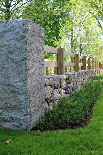 Outdoor arena fencing. I quite like the idea of hedges but this is a very nice fence with the rock and railing.